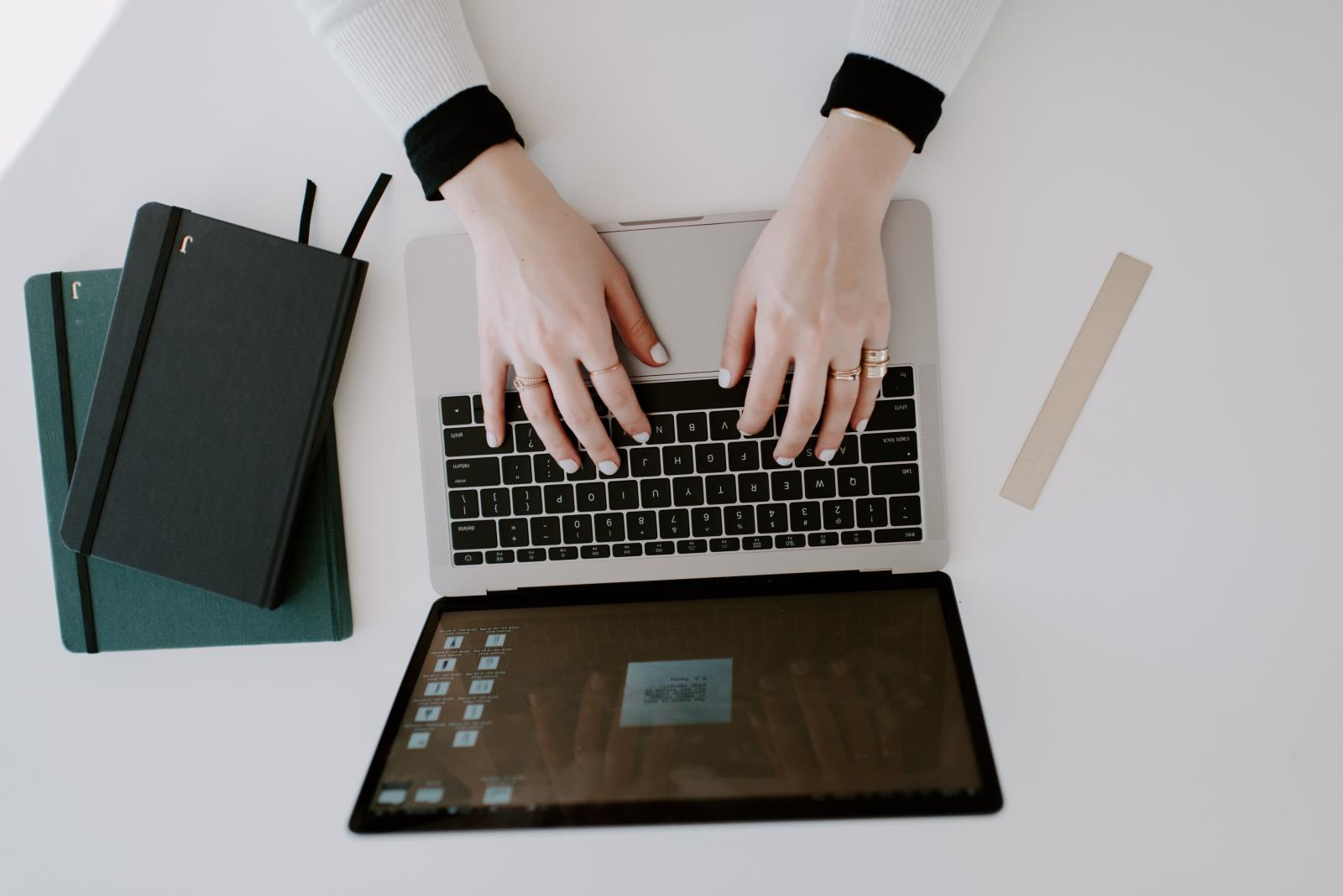 female_business_owner_working_on_a_laptop_in_a_stylish_minimal_space_t20_do2199.jpg